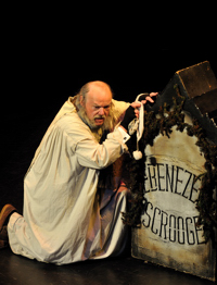 Joe Zink as Scrooge