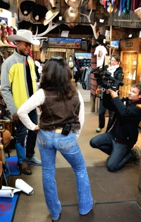 Michael Newman tries boots at Solano's Boot & Western Wear