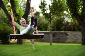 Betty Gandy swings, with daughter Page Gandy, Raton, by Tim Keller