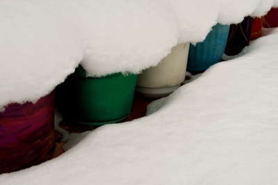 Garden pots under deep snow