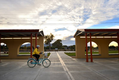 Sunrise bicyclist at Raton depot, by Tim Keller