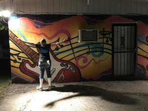 Christina Boyce plays with the night light in San Marcos, Texas