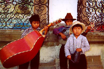 Mayan boys street busking in Oaxaca, 2004, by Tim Keller